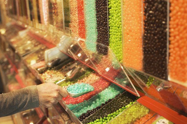 Woman scooping jelly beans in candy store