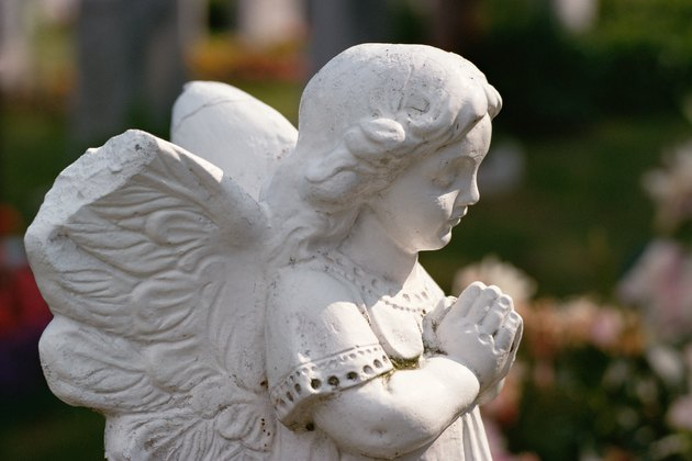Statue of angel praying