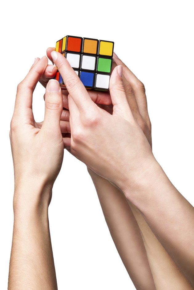 Hands holding color cube