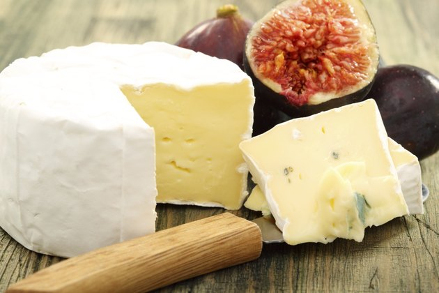 Cheese and fresh figs closeup.