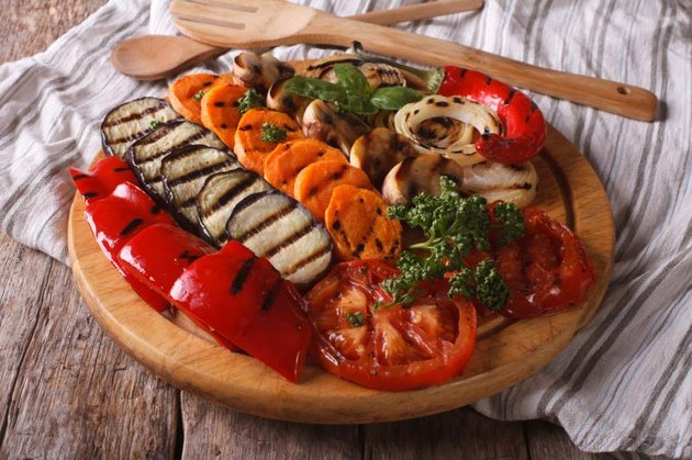 Grilled vegetables on a kitchen board on a table close-up. horizontal