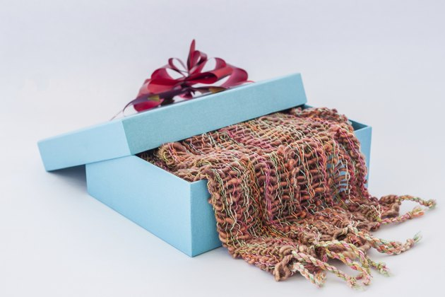 blue gift box with red ribbon and  Striped scarf
