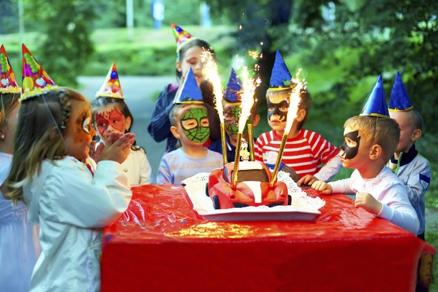 happy kids around birthday cake