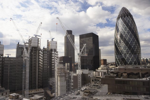 England, London, Sir Norman Foster Building and cityscape