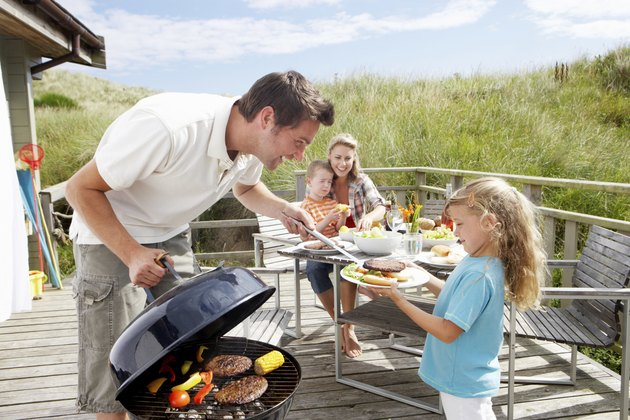 Family on vacation having barbecue