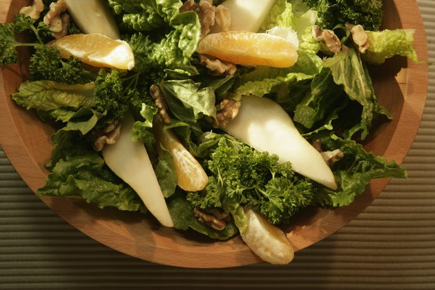 Mixed green salad with oranges and nuts