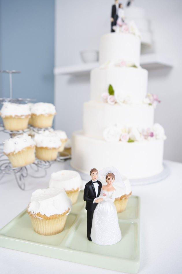 Wedding cake, cupcakes, and wedding figurines