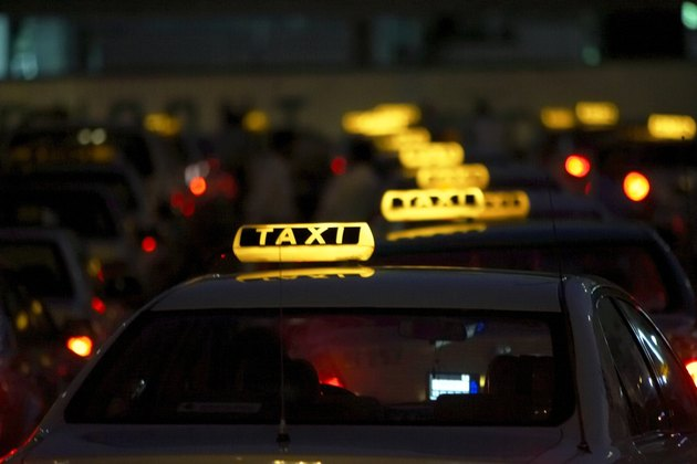 Row of illuminated taxis