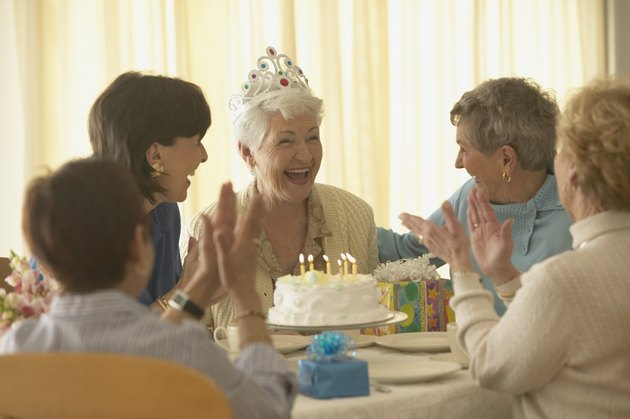 Senior woman celebrating birthday with friends