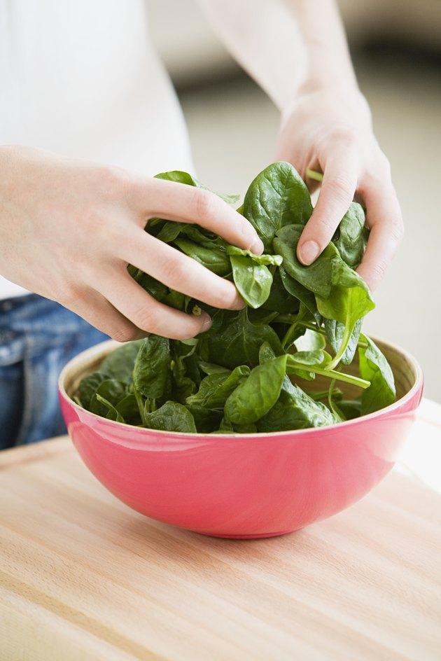 Person preparing spinach