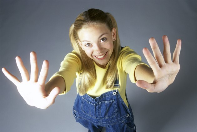 High angle view of a teenage girl with her arms stretched out