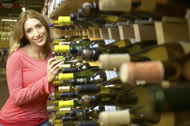 Woman at a wine rack