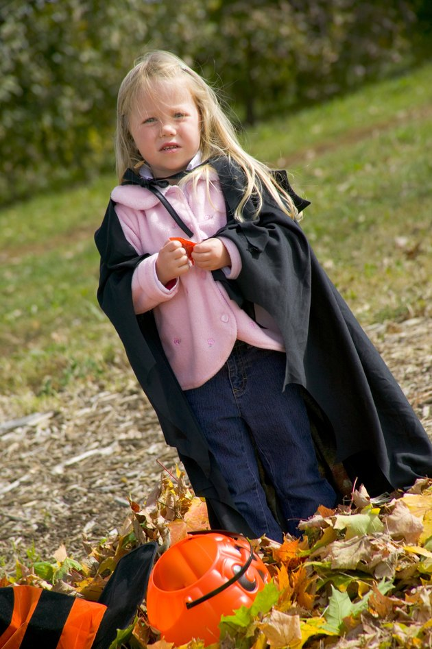 Child in Halloween witch costume