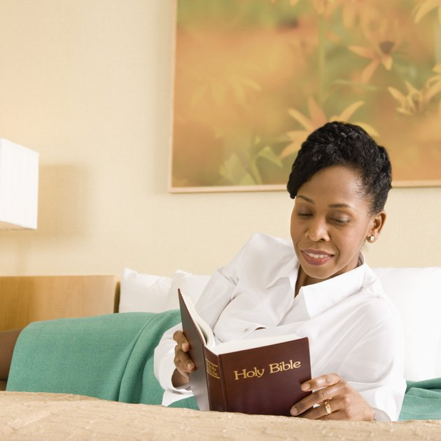 Businesswoman reading bible