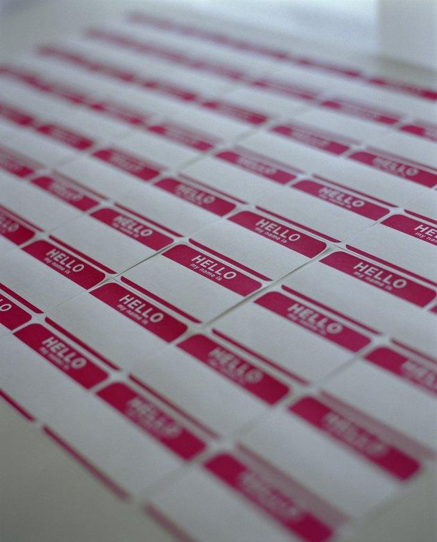 Adhesive name tags