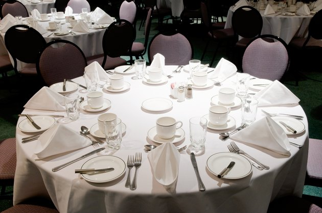 Tables with place settings in banquet room