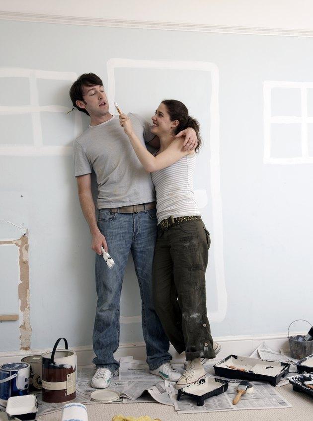 Couple playing around with house paint