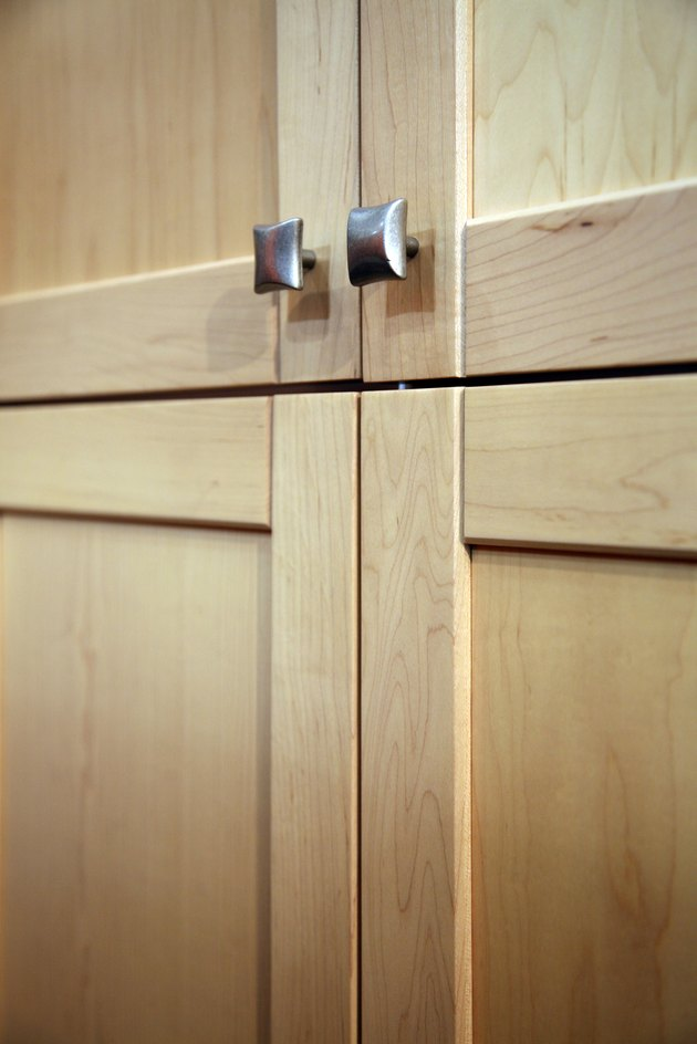 Contemporary wooden cabinets with metal knobs