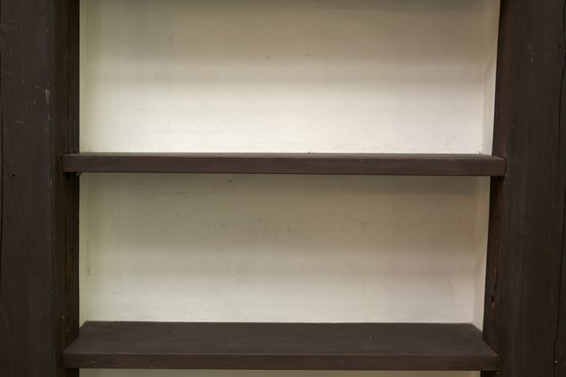 Close-up of empty wooden shelves