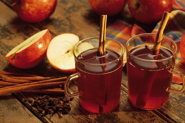 Hot spiced cider with cinnamon sticks