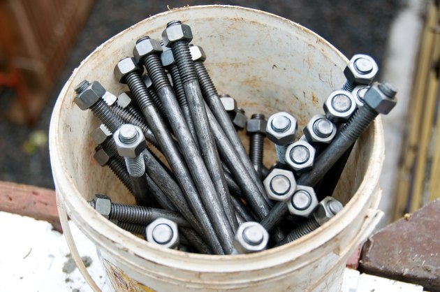 Close-up of bucket of nuts and bolts at construction site