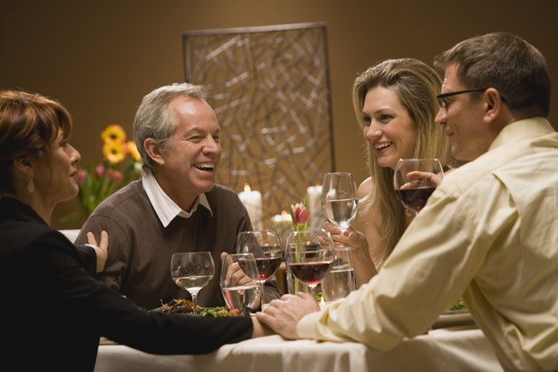 Friends chatting at dinner party