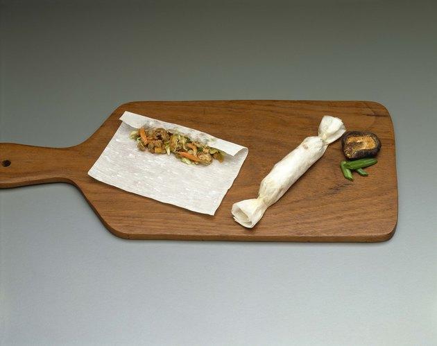 Spring roll on cutting board