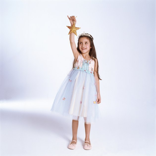 Girl in princess outfit holding star