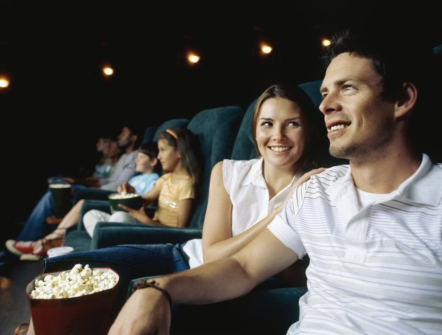 Young couple sitting in a movie theatre