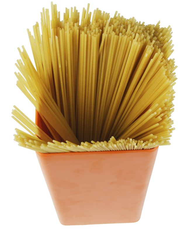 Container of uncooked spaghetti