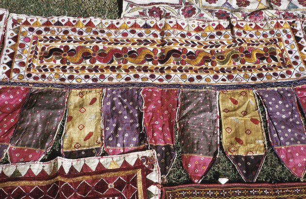 Colorful quilted fabrics on lawn in India