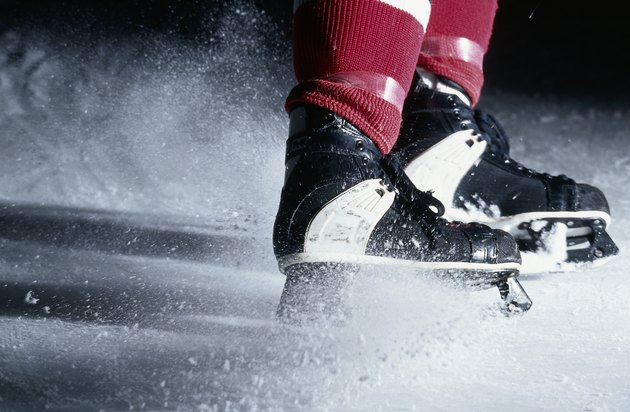 Clouds of ice from abrupt stop by hockey player
