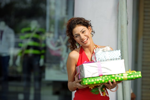 A young woman holding gift packs