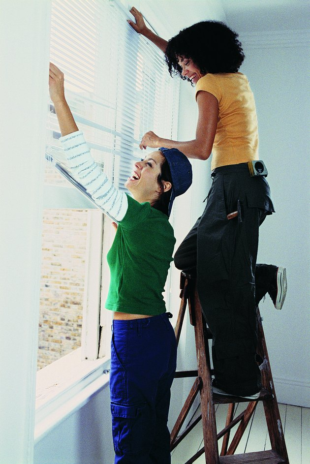Young Women Installing Blinds