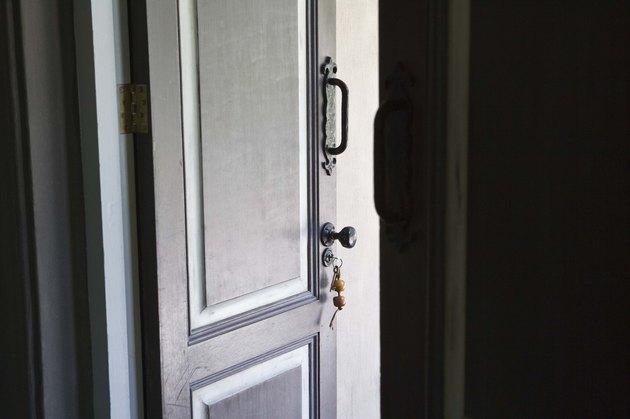 Door ajar with key