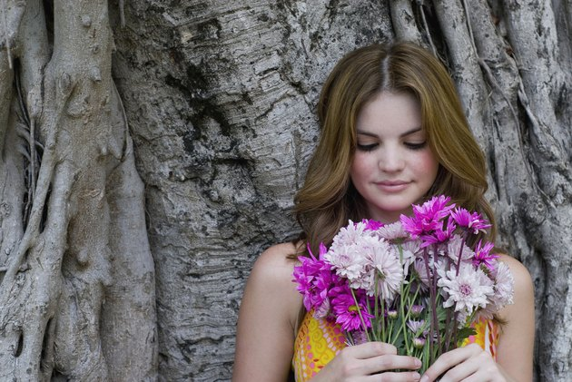 Close-up of a young woman holding a bouquet of flowers