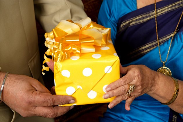 Senior couple sharing gifts