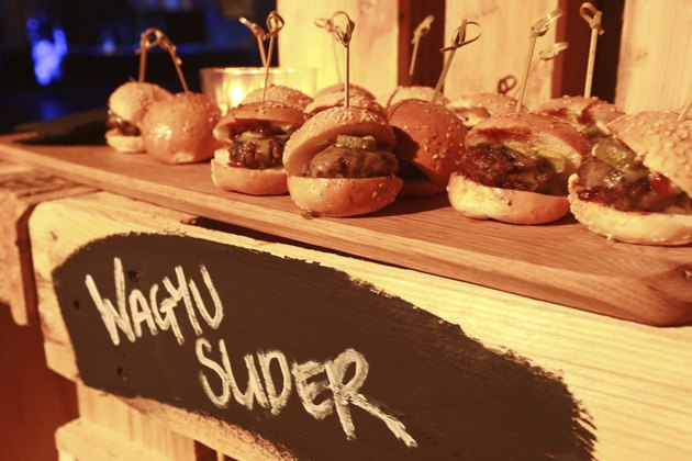 Hamburger slider on a rustic cutting wooden board.
