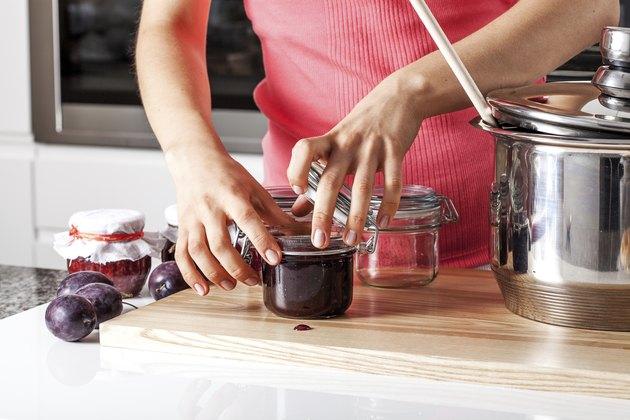 Woman closing the jars