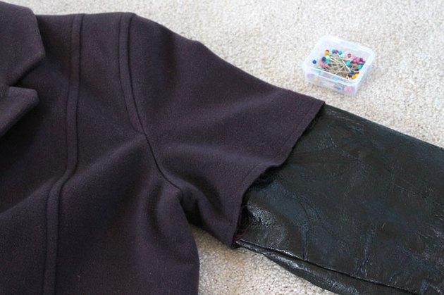 Place leather sleeve inside jacket sleeve.