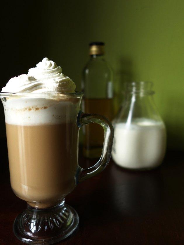 Mug of Irish Coffee with homemade low-carb sugar-free Irish cream liqueur.