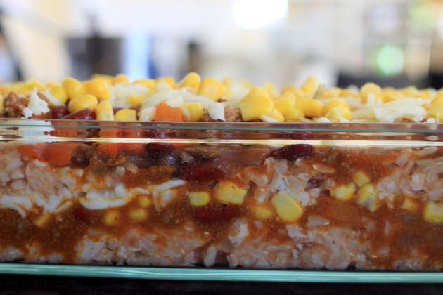 Layers of rice, meat and beans, corn and cheese.