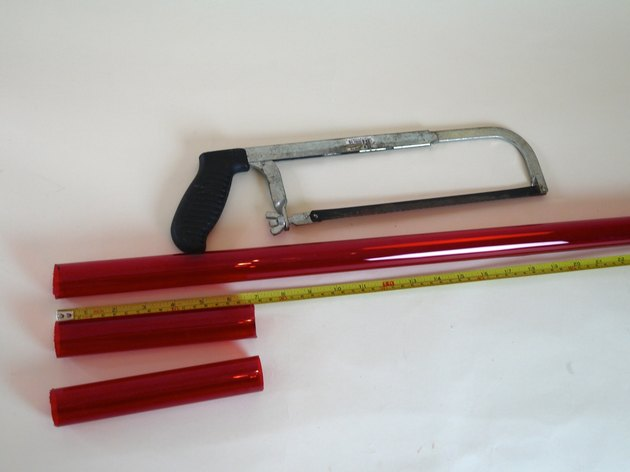 A hand saw with the lamp sleeve cut into 3 parts.