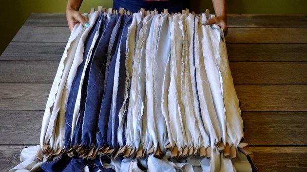 Warping cardboard rag rug loom.