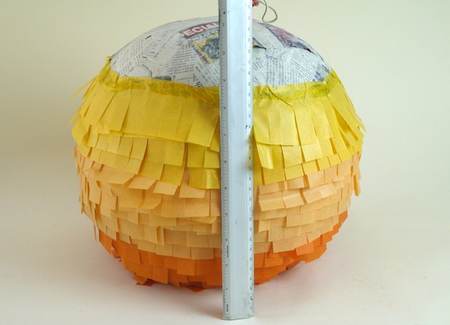 Three colors of fringe covering 3/4 of the balloon.