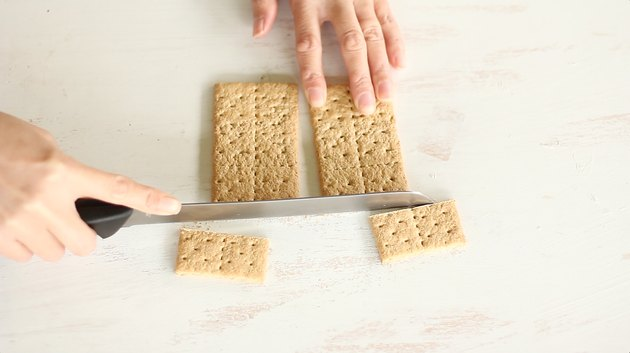 Slicing bottom fourth off two crackers