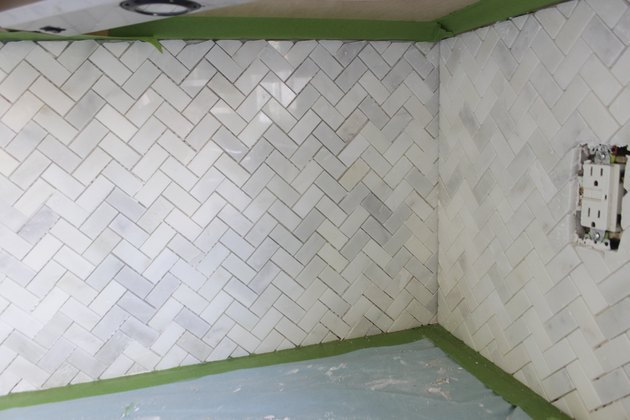 Mosaic wall tile meeting at a corner.