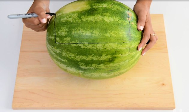 Trace out where you want to cut into the watermelon.