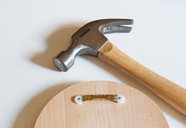 Attach sawtooth hanger to wooden plaque