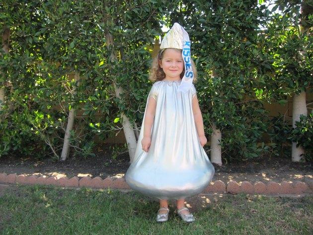 little girl wearing a Hershey's Kiss costume